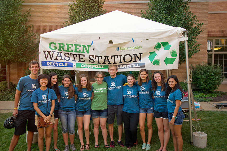 group standing in front of Green Waste Station tent