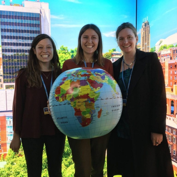 students standing around a globe